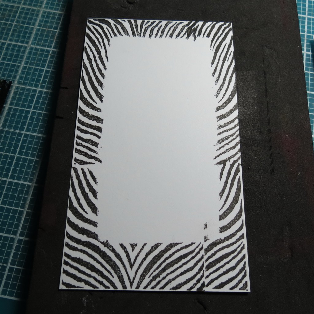 using a scrap paper to create a mask, stamp around the edges for a matching border