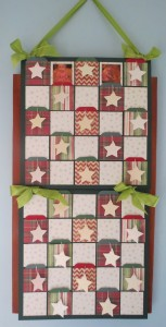 Countdown to Christmas: This banner Advent Calendar with spots for photos , pockets for tags and stars to decorate.