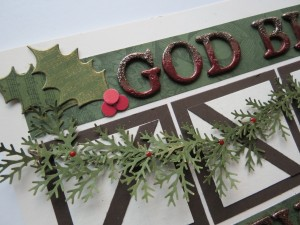 A Dickens' Christmas: Holly stamped with music, red berries and a touch of gold dusted edges, Chipboard letters embossed and glittered to make a grand border.