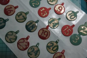 Countdown to Christmas: stage one: add glitter, stage two: add acrylic, stage three: allow time to dry.