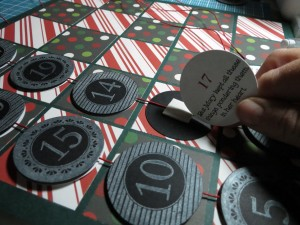 Countdown to Christmas: fitting the story disc to the backside of the date tag.