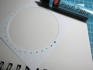 Birthday Scrapbook Pages: adding a circle of pearl dots around the frames.