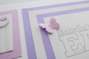Embellishing Your Scrapbook Pages: Die cut butterfly is scored and bent to create a feeling of movement and secured with glue dot.