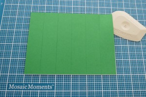 Scrapping with Ease: Cutting Mats: Step 4 Using Mosaic Moments Lil' Chisler helps to lift pieces from the grid.