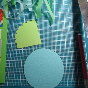 Baby Shower Scrapbook Ideas: Begin with Spellbinders Scallop and Small Circles Dies to create the baby carriage.