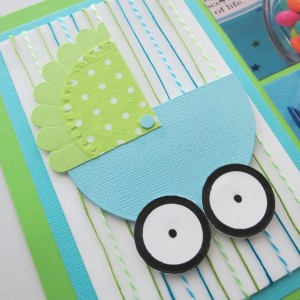 Baby Shower Scrapbook Ideas: foam mounting tape adhered to back of carriage makes this a 3-D piece.