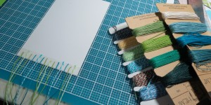 Baby Shower Scrapbook Ideas: Using twine and cording to create a unique backdrop for this block tile.