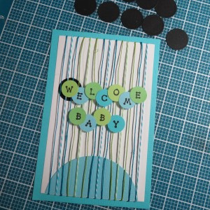 Baby Shower Scrapbook Ideas Arranging circles with letters for title on the block...testing the idea of a black circle behind each letter.