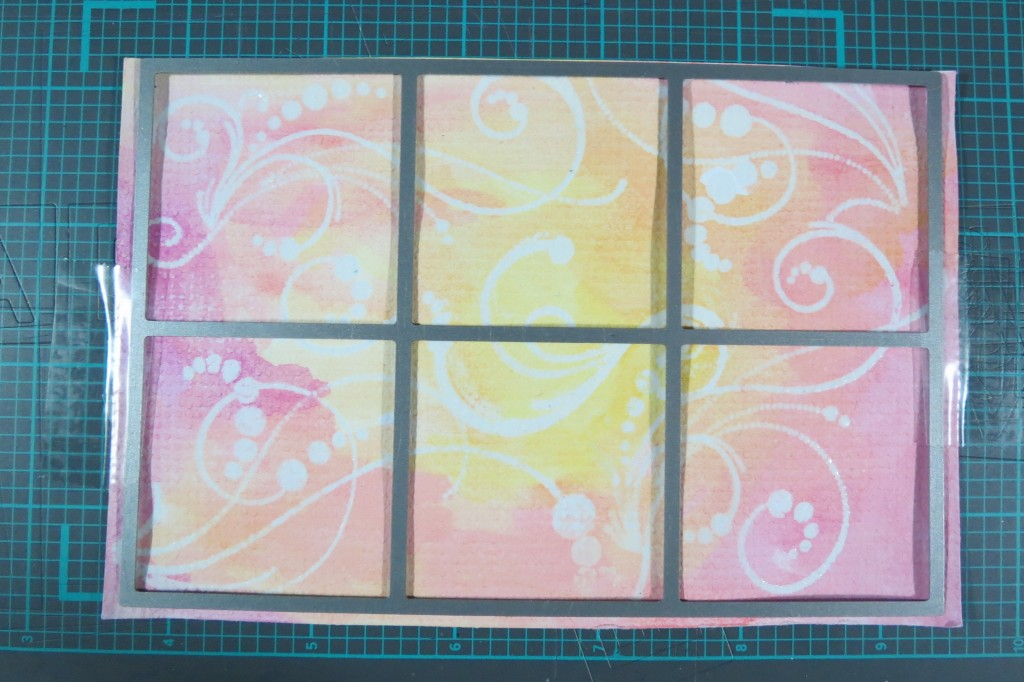 """MM Water Color applied over the heat set embossed images (3) and cut with 1.875"""" grid squares die"""